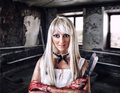 Fantastic woman in style of doll killer the zombie or a ghost with a bloody hatchet hand Royalty Free Stock Photo