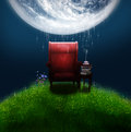 Fantasy armchair under a big moon red and table with books and cup o tea Royalty Free Stock Photo