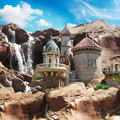 Fantasy castle on the cliffs with a waterfall background Royalty Free Stock Images