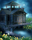Fantasy cottage with roses Stock Image