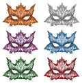 Fantasy masks in different colours illustration of with autumn leaf design Royalty Free Stock Photos