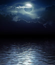 Fantasy moon and clouds over water elements of this image furnished by nasa Royalty Free Stock Images