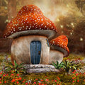 Fantasy mushroom cottage on a colorful meadow Royalty Free Stock Photography