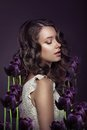 Fantasy portrait of young woman with violet tulips cute Royalty Free Stock Photo