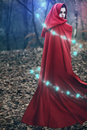 Fantasy runes magic beautiful woman with red flying cloak and swirling around Stock Image