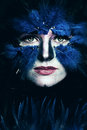 Fantasy stage makeup woman with art makeup blue bird face Stock Images