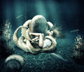 Fantasy underwater marine world octopus ensnares young beautiful woman with long hair Stock Photography