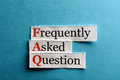 Faq abbreviation frequently asked question concept for website service on paper Royalty Free Stock Images