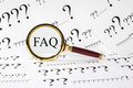 Faq concept a conceptual look at frequently asked questions a magnifyimg glass over the letters and a question mark Royalty Free Stock Photography