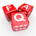 Faq frequently asked questions red dice letters on three to illustrate answers to your common inquiries Royalty Free Stock Photo