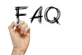 Faq frequently asked questions written on whiteboard Stock Photo