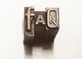 Faq letters with vintage grunge letterpress type Stock Image