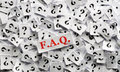 Faq question marks on white papers hard light Stock Image