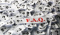 Faq question marks of on white papers hard light Royalty Free Stock Photos