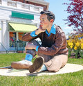 Far out sculpture by seward johnson an american artist best known for his life size bronze statues of people engaged in day to day Royalty Free Stock Photo