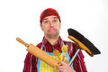Far too much housework angry man with broom and kitchen tools Stock Photos