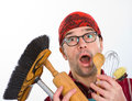 Far too much housework overstrained man with broom and kitchen tools Stock Photos