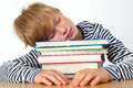 Far too much learning boy is sleeping on his books Royalty Free Stock Image