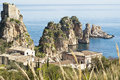 Faraglioni at scopello with tonnara sicily Royalty Free Stock Image