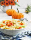 Farfalle with pumpkin and parmesan pasta cheese in a white bowl Royalty Free Stock Photo
