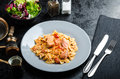 Farfalle with tomato sauce and roasted salmon Royalty Free Stock Photo