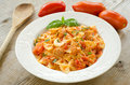 Farfalle topped with tomato sauce and tuna Stock Photo