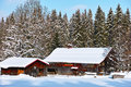 Rustic farm in snowy winter landscape Royalty Free Stock Photo