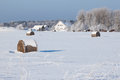 Farm barn horses bales hay laying snow farm winter field Royalty Free Stock Images
