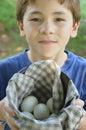 Farm Boy With Fresh Eggs Royalty Free Stock Photo