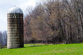 Farm in early spring view of a west virginia showing a weather worn silo and trees with faint buds starting to show Royalty Free Stock Photo