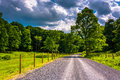 Farm Field Along A Dirt Road I...
