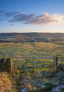 Farm gate and fields in yorkshire in winter a farmhouse the yorshire dales on a frosty day Royalty Free Stock Photo