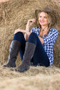 Farm girl daydreaming beautiful young in barn Stock Photos
