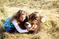 Farm girl and pet cow Royalty Free Stock Image