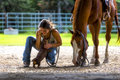 Farm girl on phone with horse and dog Royalty Free Stock Photo