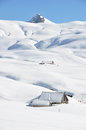 Farm house buried under snow melchsee frutt switzerland Royalty Free Stock Photography