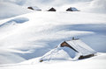 Farm house buried under snow melchsee frutt switzerland Royalty Free Stock Photo