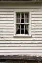 Farm house window abandoned with curtain still on the Stock Images