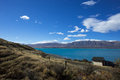 A farm on lakeside of the lake tekapo in new zealand sheep is located at town called is beautiful turquoise Stock Images