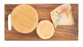 Farm produced rustic cheese including blue on cheeseboard real organic overhead view isolated Stock Image