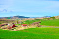 Farm in spring within beautiful hills Royalty Free Stock Photo