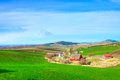 Farm in spring within rolling hills Stock Photo
