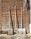 Farm tools in front of a swiss wooden old barn Royalty Free Stock Image