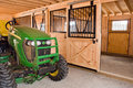 Farm tractor in barn Stock Image