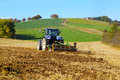 Farm tractor on the field working Royalty Free Stock Photo