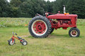 Farm tractor and tricycle Royalty Free Stock Photo