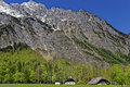 Farm in valley at a mountain massif Royalty Free Stock Photo