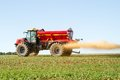 Farm Vehicle spreading lime onto a field Royalty Free Stock Photo