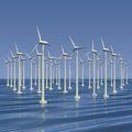 Farm of wind generators at sea or electrical Stock Photos