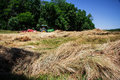 Farmer bales hay a his field using tractor Royalty Free Stock Photography